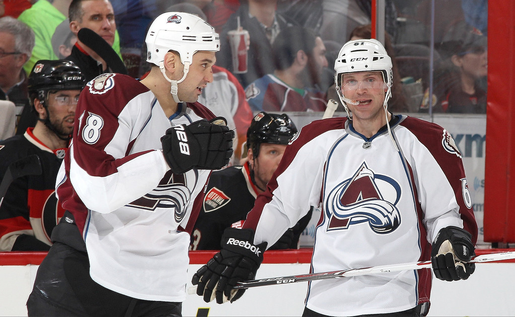 . Andre Benoit #61 of the Colorado Avalanche celebrates his second period goal against the Ottawa Senators with team mate Patrick Bordeleau #58 during an NHL game at Canadian Tire Centre on March 16, 2014 in Ottawa, Ontario, Canada.  (Photo by Jana Chytilova/Freestyle Photography/Getty Images)