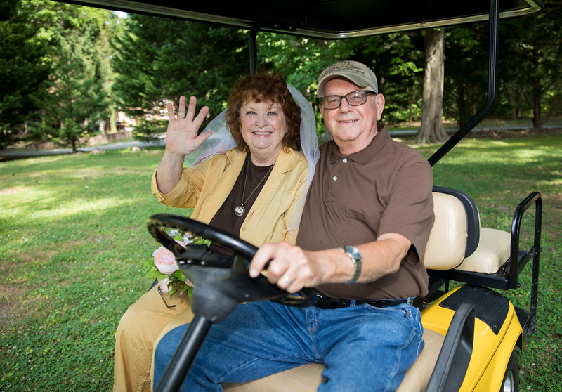 Mam and Badge on Golf Cart 1.jpg