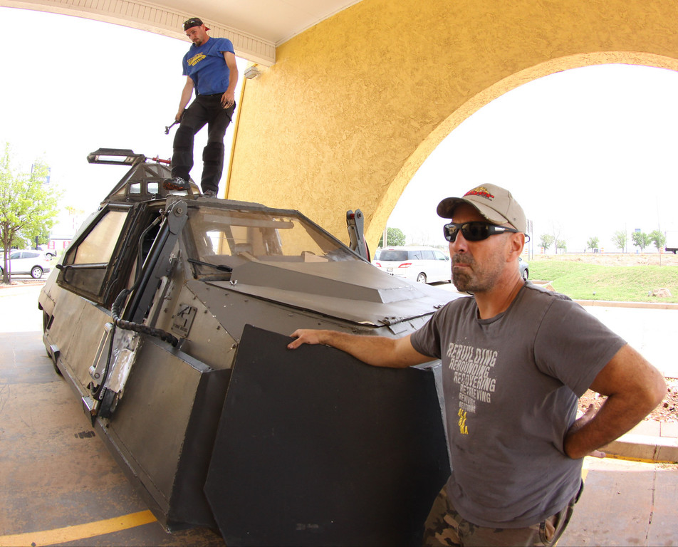 . Sean Casey(R) IMAX film-maker/Storm Chaser with TIV-2 (Tornado Intercept Vehicle) and driver Jonathon Morrison as they gets ready to start on another tornado IMAX film with the National Geographic in El Reno, Oklahoma Friday April 25,2014.April  26,2014.