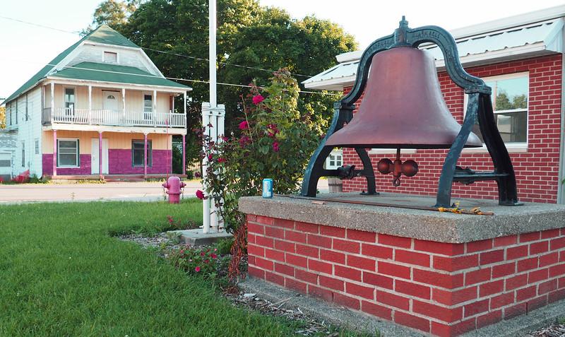 Old bell on the east side of the Wright-Waldron Municipal Building (where fire station doors are located)