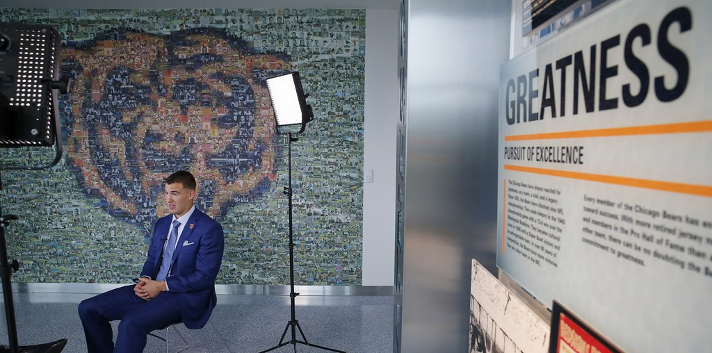 . The Chicago Bears\' first round draft pick quarterback Mitchell Trubisky, left, gives a one on one television interview after an NFL football news conference Friday, April 28, 2017, in Lake Forest , Ill. (AP Photo/Charles Rex Arbogast)