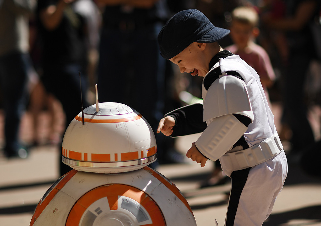. Turner Russell, 4, is all smiles when meeting BB-8 outside the Denver Art Museum, May 04, 2016. The museum held a May the 4th Be With You event to kick off ticket sales for the upcoming exhibition, Star Wars and the Power of Costume, opening at the DAM in November. (Photo by RJ Sangosti/The Denver Post)