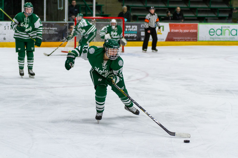 Holy Family's Taylor Koeppl '23 (14) vs. Eden Prairie at Braemar Arena - Collin Nawrocki/The Phoenix