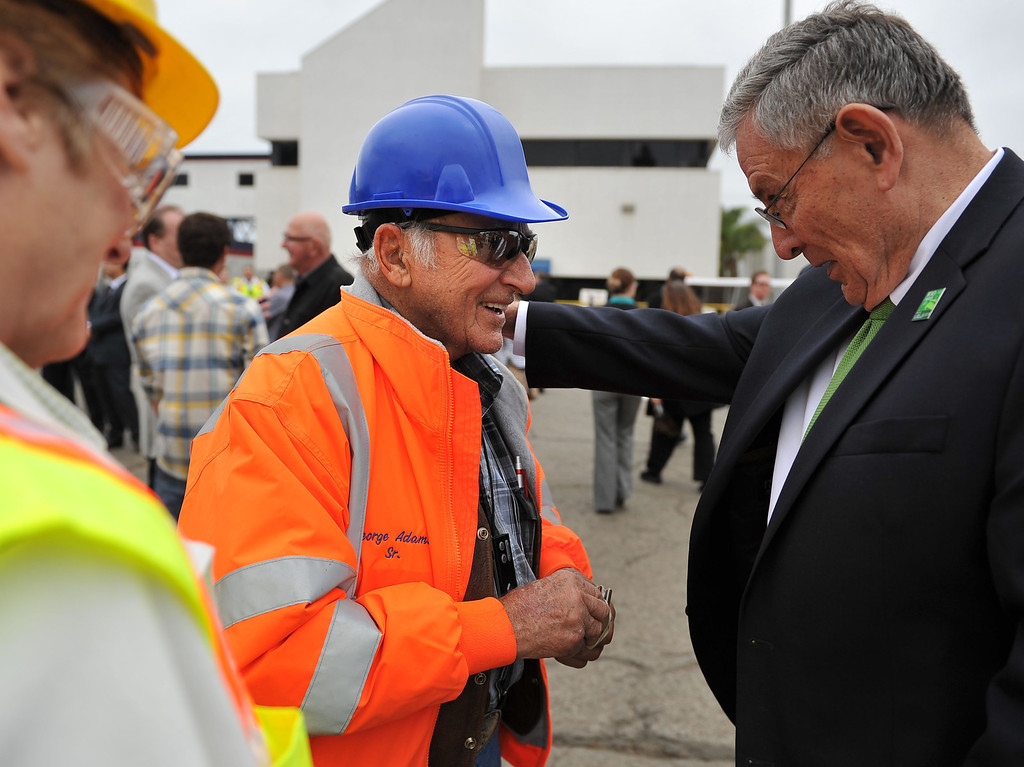 . 4/30/13 -  Longtime scrap metal exporter and Port of Long Beach tenant SA Recycling held a reception to celebrate its expansion of business to include bulk shipments of iron ore overseas. These shipments are the first-ever iron ore to be exported from the Port of Long Beach.   George Adams Sr., center,  chats with Doug Drummond, of the Harbor Comminssion. Photo by Brittany Murray / staff photographer