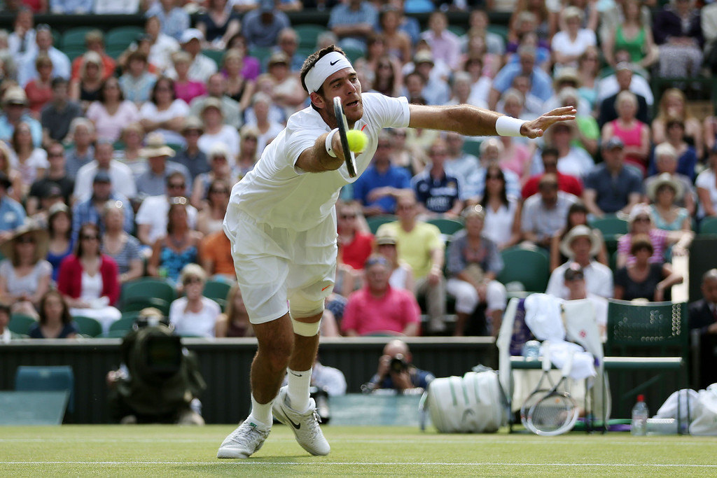 . LONDON, ENGLAND - JULY 05:  Juan Martin Del Potro of Argentina dives to volley the ball during the Gentlemen\'s Singles semi-final match against Novak Djokovic of Serbia on day eleven of the Wimbledon Lawn Tennis Championships at the All England Lawn Tennis and Croquet Club on July 5, 2013 in London, England.  (Photo by Clive Brunskill/Getty Images)