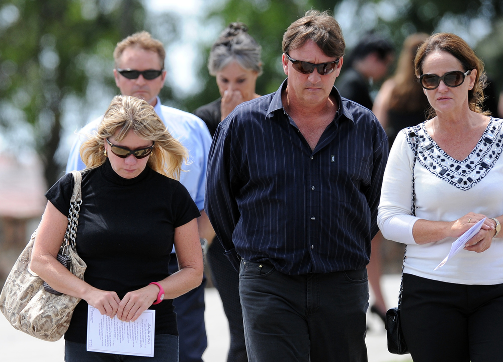 ". Relatives and friends of late South African model Reeva Steenkamp gather for the funeral ceremony at the crematorium building in Port Elizabeth on February 19, 2013. The 29-year-old law graduate and cover girl was gunned down four times on February 14, 2013 at the upmarket Pretoria home of the Olympic and Paralympic star Oscar Pistorius. South African prosecutors on February 19 told a bail hearing that Oscar Pistorius was guilty of ""premeditated murder\"" in the Valentine\'s Day killing of his model girlfriend at his upscale home.  ALEXANDER JOE/AFP/Getty Images"
