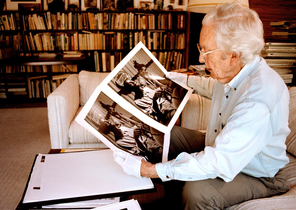. Photojournalist Wayne Miller looks over his prints of images of South Chicago he photographed in the late 1940\'s.    (Stephen J. Pringle/Bay Area News Group Archives)