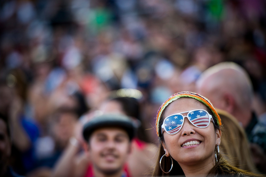 . Lorraine Cabatingan-Beddawi watches the 88th Annual Fourth of July Celebration, Americafest at the Rose Bowl in Pasadena Friday night, July 4, 2014. (Photo by Sarah Reingewirtz/Pasadena Star-News)