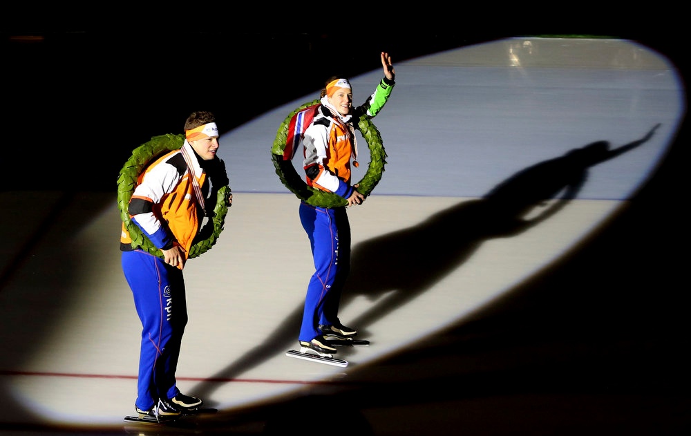 . Sven Kramer, left, and Ireen Wust, both of the Netherlands, wearing their laurels as they parade after winning the overall titles in the World Speed skating Championships Sunday Feb. 17, 2013, in the Viking Ship Arena in Hamar, Central Norway. (AP Photo / Hakon Mosvold Larsen, NTB scanpix)