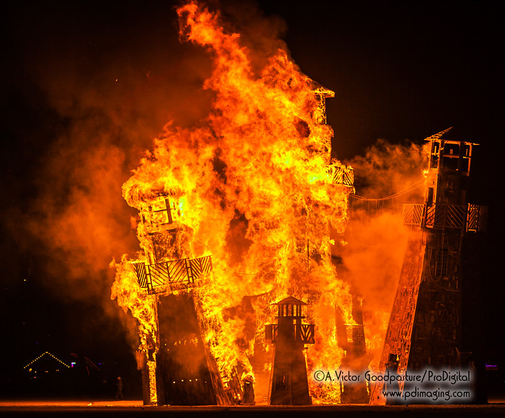 The Black Rock Lighthosue Service goes up in flames, surrounded by thousands of burners and dozens and dozens of art cars.