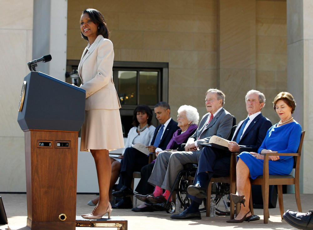 . Former U.S. Secretary of State Condoleezza Rice (L) delivers remarks at the dedication ceremony for the George W. Bush Presidential Center in Dallas, April 25, 2013. Behind Rice are (L-R) first lady Michelle Obama, President Barack Obama, former first lady Barbara Bush, former President George H.W. Bush, former President George W. Bush and former first lady Laura Bush. REUTERS/Jason Reed