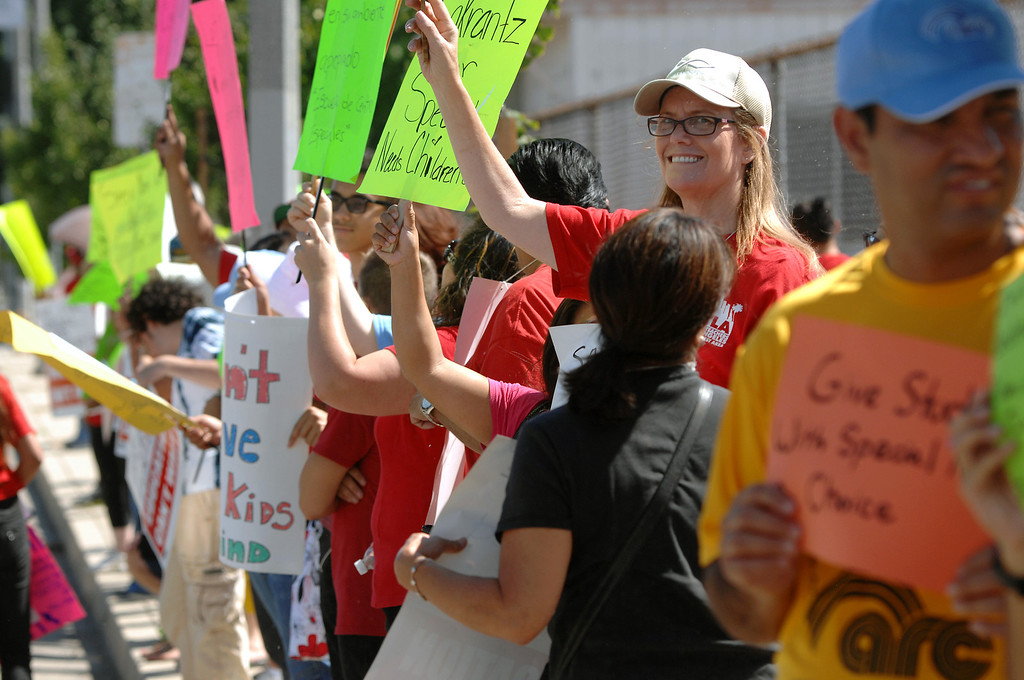 . Protesters line Balboa Boulevard in front of the office of LAUSD board member Tamar Galatzan, Wednesday, July 24, 2013. Parents and Teachers United for Action picketed to voice their opposition to the district�s transitioning of special education students onto regular education campuses. (Michael Owen Baker/L.A. Daily News)