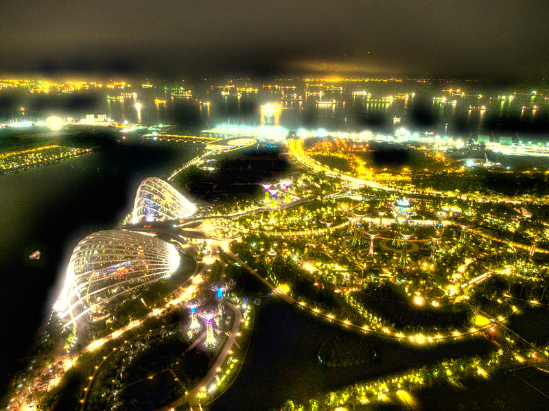 Difficult handheld HDR from atop the Sky Garden in Singapore.     Way over processed as you can see in the water, I will eventually learn to mask that affect out.