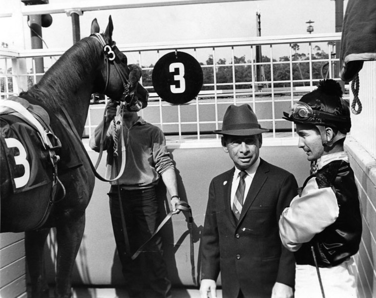 ". Trainer John Longden gives jockey Bill Shoemaker riding instructions for ""Attention 3rd\"" in the 7th race at Hollywood Park.  Photo dated: May 11, 1966   (Los Angeles Public Library)"