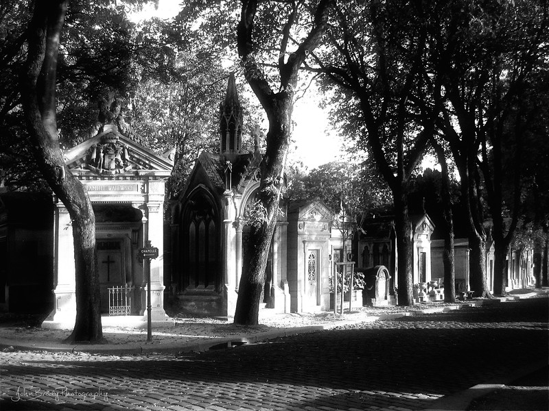 This shot of Pere Lachaise Cemetery in Paris ended up as a cover on a Wall Street Journal Europe section about the cemeteries across Europe. Kind of fun, and I had the WSJ send the license fee to UNICEF, so everybody was happy :)  Final resting place of Chopin, Delecroix, and to the annoyance of the cemetery guards, (due to Doors lyrics carved on surrounding 200 year old tombs...) Jim Morrison of the Doors - JohnBrody.com / John Brody Photography