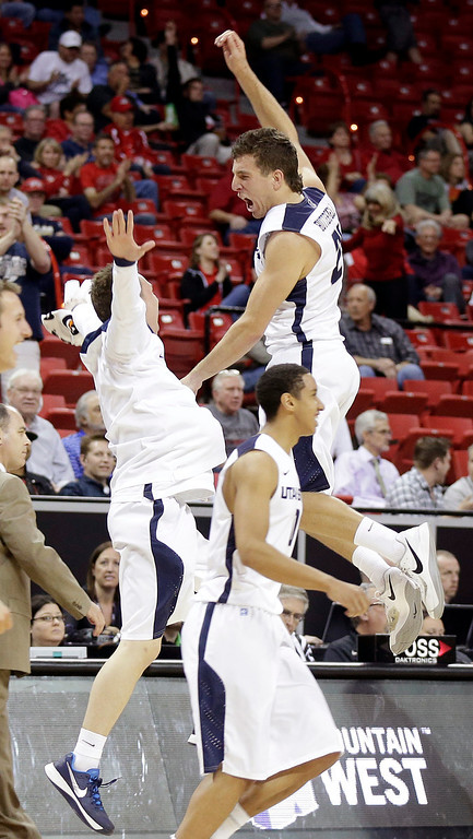 . Utah State\'s Spencer Butterfield, right, celebrates with a teammate following a Mountain West Conference tournament NCAA college basketball game against Colorado State Wednesday, March 12, 2014, in Las Vegas. Utah State defeated Colorado State 73-69. (AP Photo/Isaac Brekken)