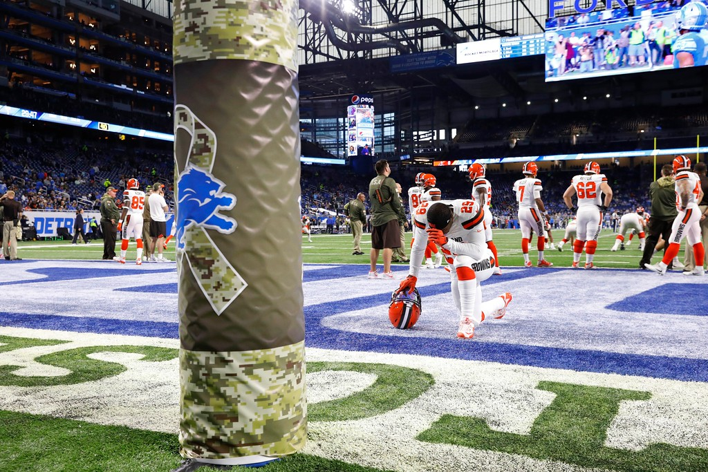 . Cleveland Browns running back Duke Johnson (29) takes a knee near a Salute to Service decorated goal post during the first half of an NFL football game against the Detroit Lions, Sunday, Nov. 12, 2017, in Detroit. (AP Photo/Rick Osentoski)