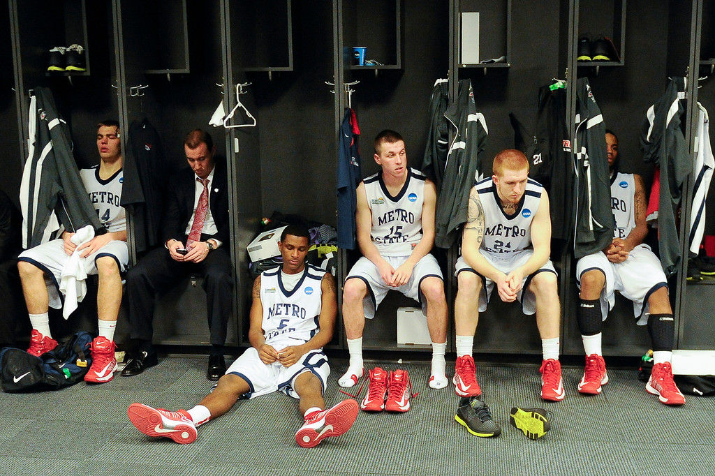 . Metro State players sit in the locker room after their 74-73 loss to Drury in the NCAA Division ll national championship college basketball game, Sunday, April 7, 2013, in Atlanta. (AP Photo/John Amis)