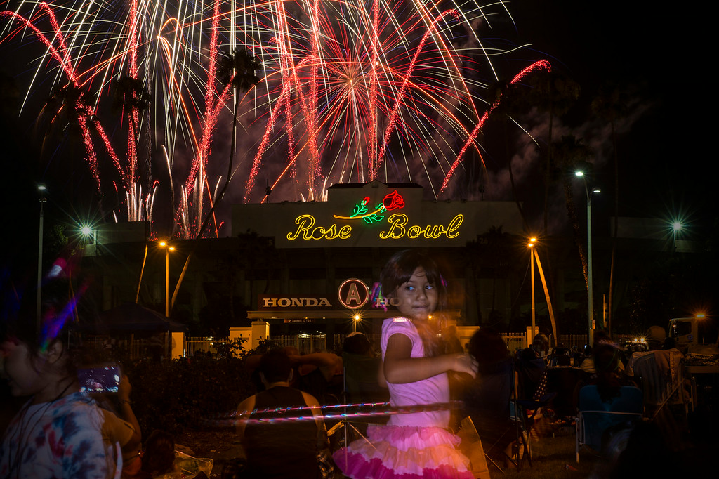 . In celebration of Independence Day more than a ton of explosives are used in Americafest\'s annual fireworks show as Yesenia Aviles, 6, of San Diego, Hula Hoops at the Rose Bowl in Pasadena Friday night, July 4, 2014. (Photo by Sarah Reingewirtz/Pasadena Star-News)