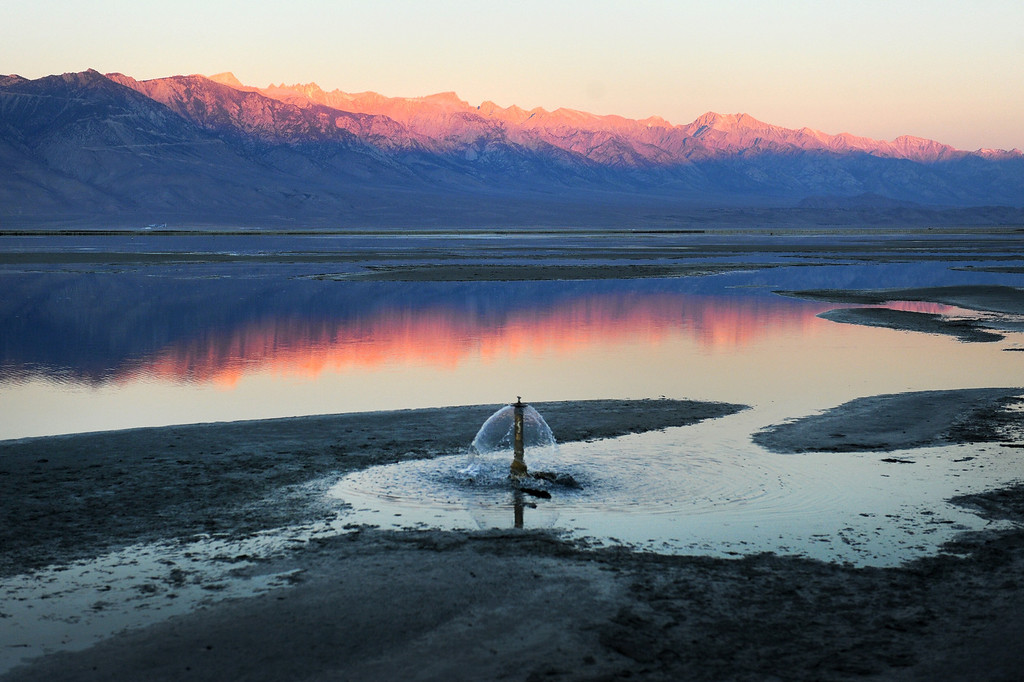 . Water is pumped into Owens Lake as part of a mitigation effort to reduce dust storms created as a result of diverting the Owens River for the L.A. Aqueduct. (Photo by Michael Owen Baker/L.A. Daily News)