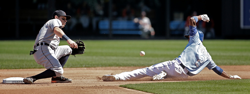 . Kansas City Royals\' Alcides Escobar (2) is caught stealing second by Detroit Tigers second baseman Ian Kinsler during the first inning of a baseball game Sunday, Sept. 21, 2014, in Kansas City, Mo. (AP Photo/Charlie Riedel)