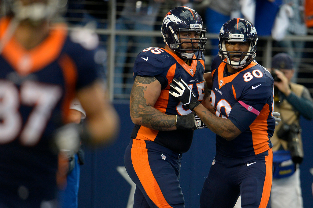 . Broncos guard Louis Vasquez, left, with tight end Julius Thomas after a Broncos touchdown at AT&T Stadium. (Joe Amon, The Denver Post)