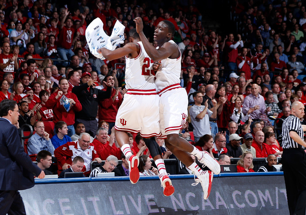 . DAYTON, OH - MARCH 22: Victor Oladipo #4 and Remy Abell #23 of the Indiana Hoosiers celebrate a three point basket by Oladipo in the first half against the James Madison Dukes during the second round of the 2013 NCAA Men\'s Basketball Tournament at UD Arena on March 22, 2013 in Dayton, Ohio.  (Photo by Joe Robbins/Getty Images)
