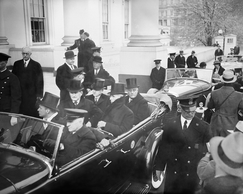 . President Herbert Hoover, left, and President-elect Franklin D. Roosevelt are shown as they left the White House for Roosevelt\'s inauguration, March 4, 1933.  (AP Photo)