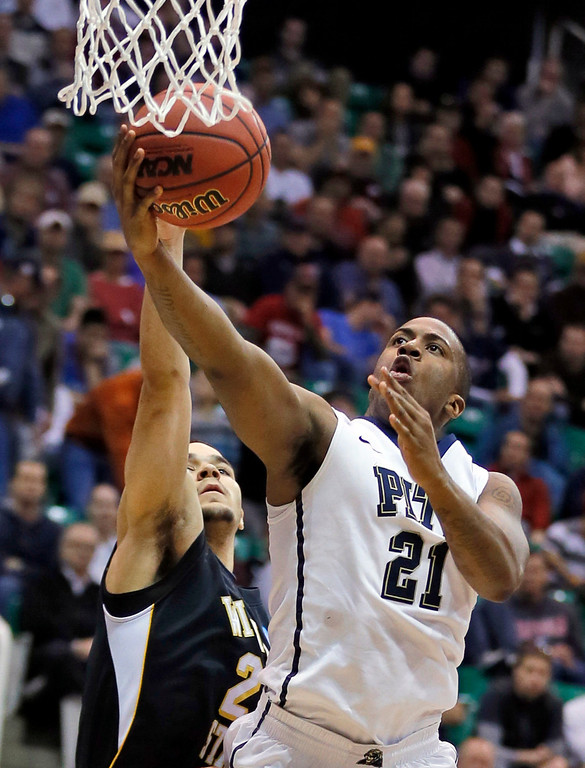 . Pittsburgh\'s Ehimen Orukpe, right, lays the ball in past Wichita State\'s Trey Zeigler during a second-round game in the NCAA college basketball tournament in Salt Lake City, Thursday, March 21, 2013. (AP Photo/George Frey)