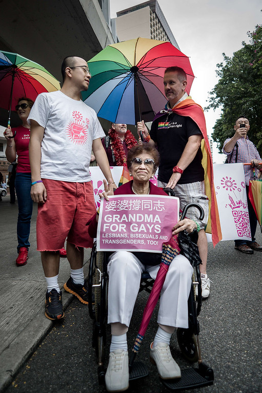 . A grandma poses with her grandson (L) during the gay pride parade in Hong Kong on November 9, 2013. Despite its reputation as an international financial hub, critics say Hong Kong remains a conservative city when it comes to gay rights, lacking protection for the sexual minority group despite having decriminalised homosexuality in 1991. PHILIPPE LOPEZ/AFP/Getty Images