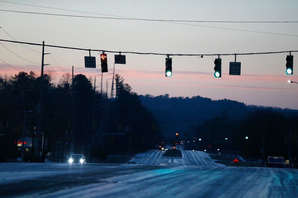 . Ice covers the roads while drivers attempted to drive, Saturday, Jan. 7, 2017, in Hoover, Ala. (AP Photo/Brynn Anderson)