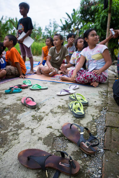 A group of young students attend a class on rainforest conservation and Orangutan protection