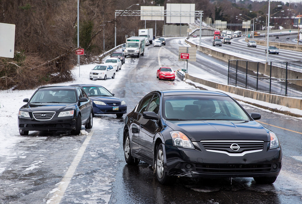 . Abandoned vehicles line an exit ramp along I-75 South during the winter storm January 29, 2014 in Atlanta, Georgia.  (Photo by Daniel Shirey/Getty Images)