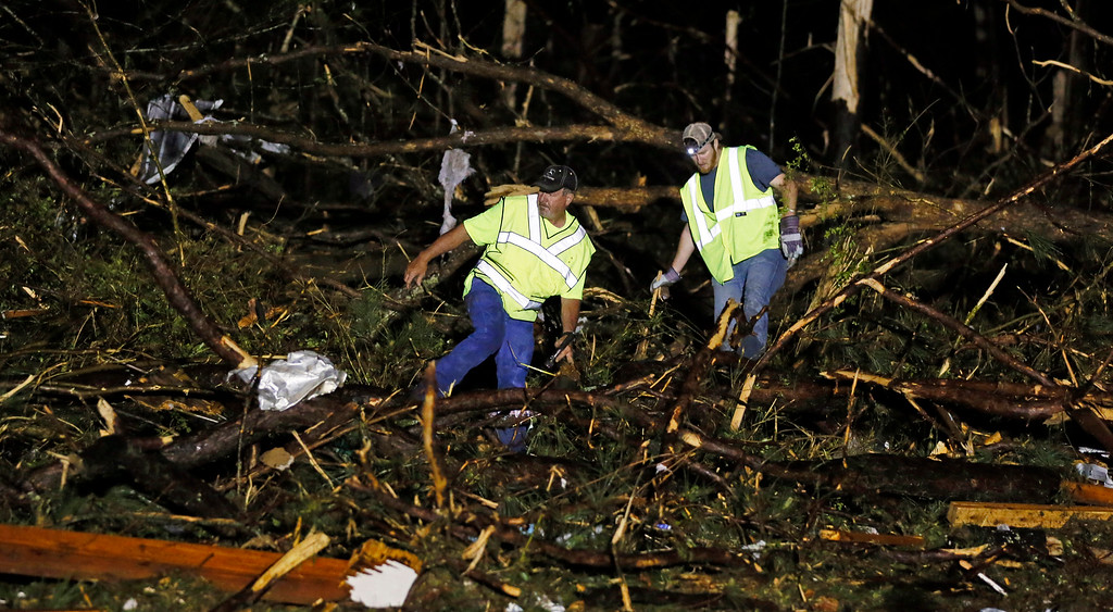 . Emergency personnel search the remains of several mobile homes in Louisville, Miss., early Tuesday morning, April 29, 2014 after a tornado hit the east Mississippi community Monday.   (AP Photo/Rogelio V. Solis)