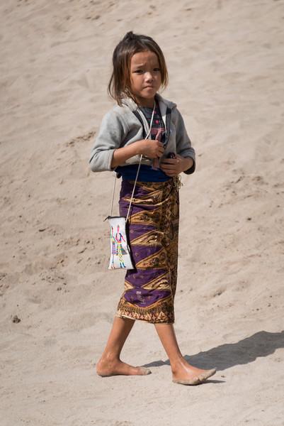 Girl walking on sand, Sainyabuli Province, Laos