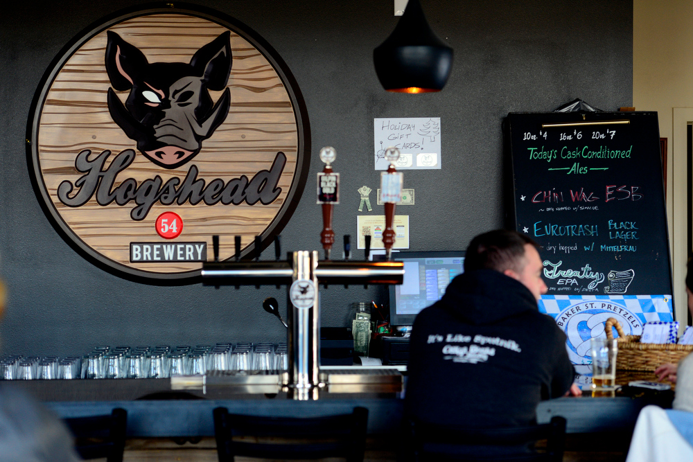 . Patrons sit at the bar of Hogshead Brewery in Denver on Sunday, January 6, 2013. AAron Ontiveroz, The Denver Post
