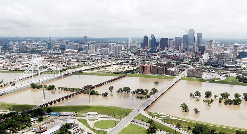 . A swollen Trinity River west of downtown Dallas, Friday, May 29, 2015. Floodwaters submerged Texas highways and threatened more homes Friday after another round of heavy rain added to the damage inflicted by storms. (AP Photo/Brandon Wade)