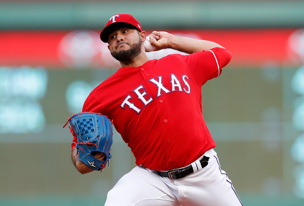 . Texas Rangers starting pitcher Martin Perez delivers to a Cleveland Indians batter during the first inning of a baseball game, Friday, July 20, 2018, in Arlington, Texas. (AP Photo/Jim Cowsert)