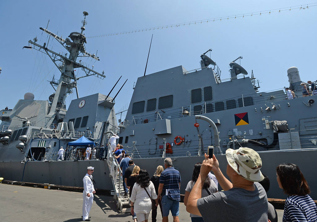 . People take photos as they prepare to board for a tour of the USS Spruance, an Arleigh Burke-class guided missile destroyer, which is docked in the Port of Los Angeles for Navy Days.   Saturday, August 09, 2014, San Pedro, CA.   Photo by Steve McCrank/Daily Breeze