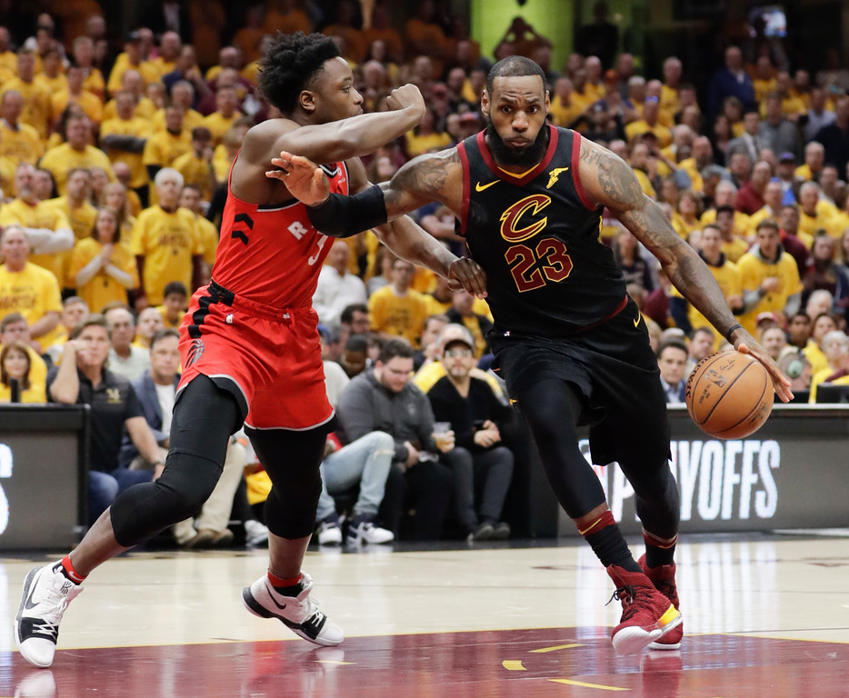 . Cleveland Cavaliers\' LeBron James (23) drives on Toronto Raptors\' OG Anunoby (3), from England, in the first half of Game 4 of an NBA basketball second-round playoff series, Monday, May 7, 2018, in Cleveland. (AP Photo/Tony Dejak)