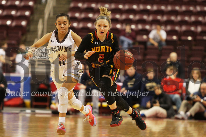 North Catholic's #2 Emma Pospisil brings the ball down court.