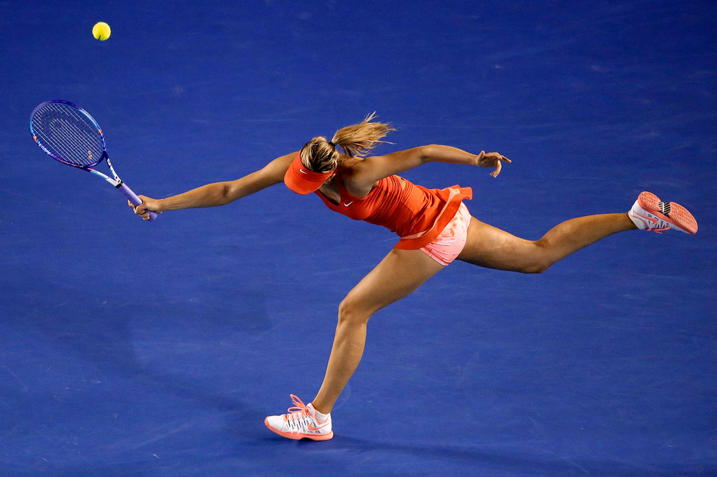 . Maria Sharapova of Russia chases down a shot to Serena Williams of the U.S. during the women\'s singles final at the Australian Open tennis championship in Melbourne, Australia, Saturday, Jan. 31, 2015. (AP Photo/Lee Jin-man)