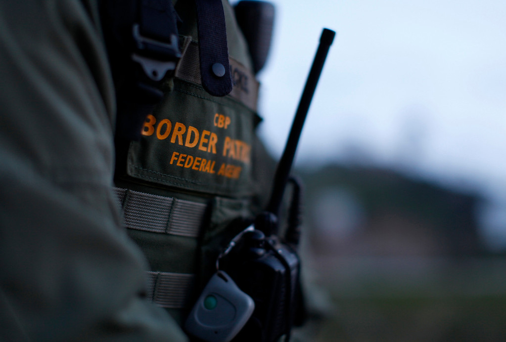 . U.S. Customs and Border Patrol agent David Faatoalia wears a radio on his chest as he patrols along the international border between Mexico and the United States near San Diego, California, March 26, 2013. Picture taken March 26, 2013. REUTERS/Mike Blake
