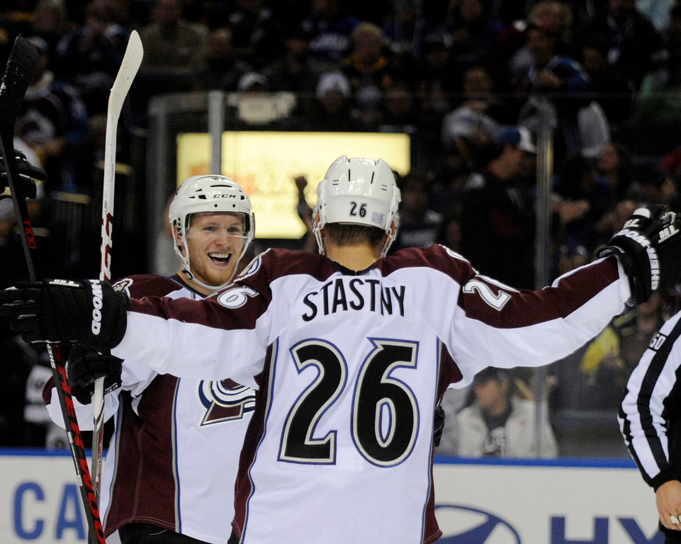 . Colorado Avalanche left winger Gabriel Landeskog, left, celebrates a goal by center Paul Stastny (26) during the second period of an NHL hockey game against the Buffalo Sabres in Buffalo, N.Y., Saturday, Oct. 19, 2013. (AP Photo/Gary Wiepert)