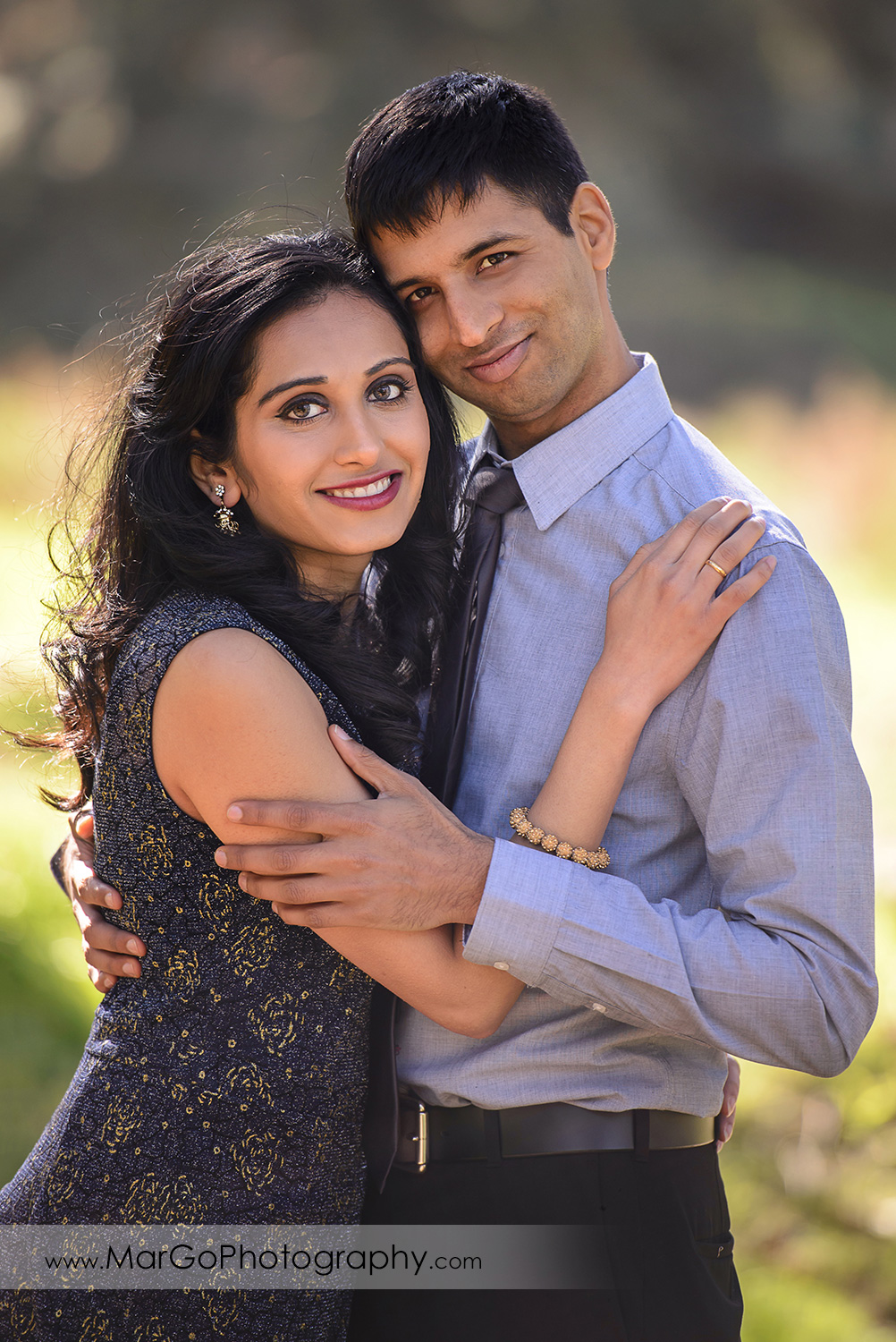 3/4 portrait of Indian couple in blue clothes during engagement session at San Francisco Presidio Park