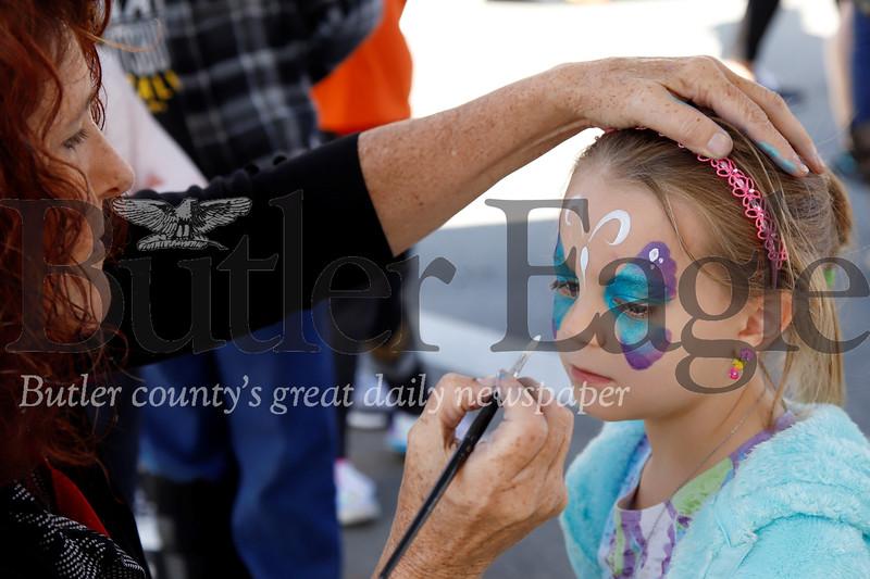 Victoria Applegate, 6, of Evans City get's her face painted at Mars Applefest. Seb Foltz/Butler Eagle