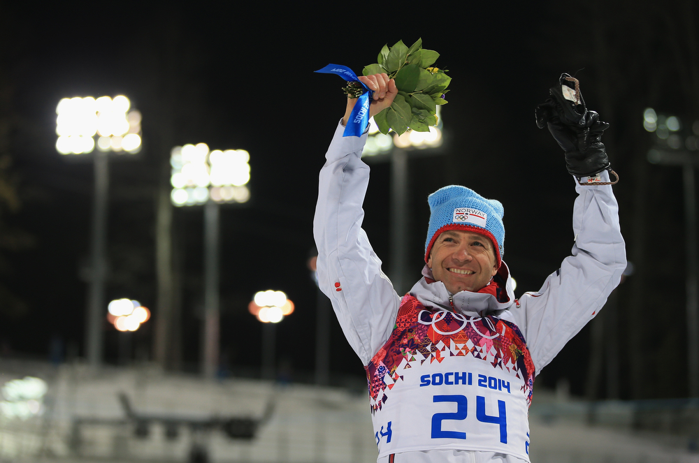 . Gold medalist Ole Einar Bjoerndalen of Norway celebrates during the flower ceremony for the Men\'s Sprint 10 km during day one of the Sochi 2014 Winter Olympics at Laura Cross-country Ski & Biathlon Center on February 8, 2014 in Sochi, Russia.  (Photo by Richard Heathcote/Getty Images)