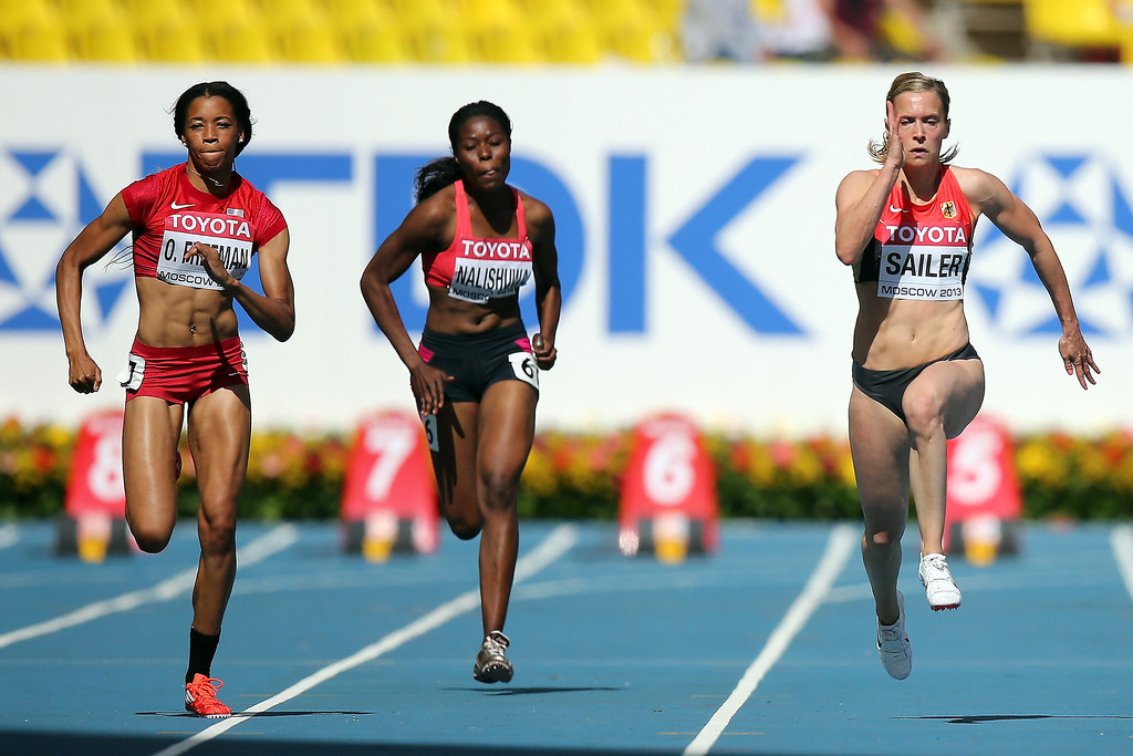. Octavious Freeman of the United States and Verena Sailer of Germany compete in the Women\'s 100 metres heats during Day Two of the 14th IAAF World Athletics Championships Moscow 2013 at Luzhniki Stadium on August 11, 2013 in Moscow, Russia.  (Photo by Ian Walton/Getty Images)