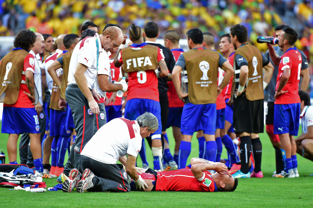 . Chile\'s defender Gary Medel receives medical treatment at the end of the second half of Round of 16 football match between Brazil and Chile at the Mineirao Stadium in Belo Horizonte during the 2014 FIFA World Cup on June 28, 2014.  (MARTIN BERNETTI/AFP/Getty Images)