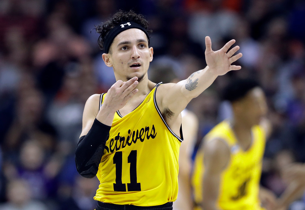 . UMBC\'s K.J. Maura (11) celebrates after a basket against Virginia during the first half of a first-round game in the NCAA men\'s college basketball tournament in Charlotte, N.C., Friday, March 16, 2018. (AP Photo/Gerry Broome)